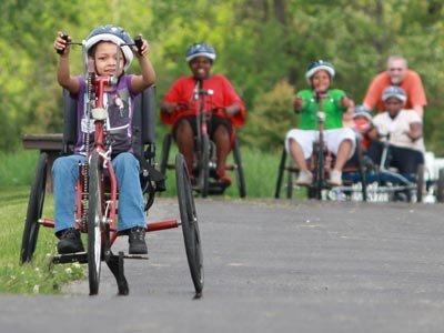 children riding adaptive bicycles